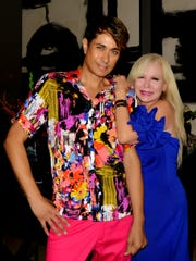 Reich wears a multicolored shirt and vibrant pant by Mario Guillen of G.Fraga. His friend, Lori Weiner, wears BCBG.