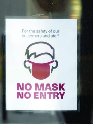 This sign is posted at an entrance to the Leavenworth County Courthouse. Visitors to the courthouse are required to wear masks, but the County Commission voted Wednesday to exempt Leavenworth County from a new mask mandate issued by the governor.