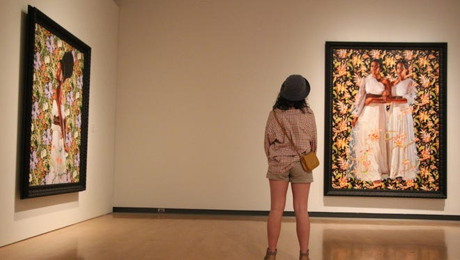 Maddie Sanford looks at Kehinde Wiley portraits at the Phoenix Art Museum.