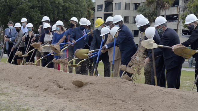 Court and City officials and others turned ground Thursday for a new Judicial Courthouse Trial Court Building.