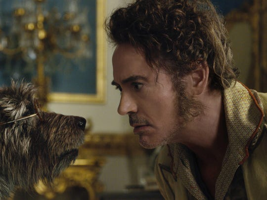 """The dog Jip (voiced by Tom Holland) and Dr. John Dolittle (Robert Downey Jr.) in """"Dolittle."""""""
