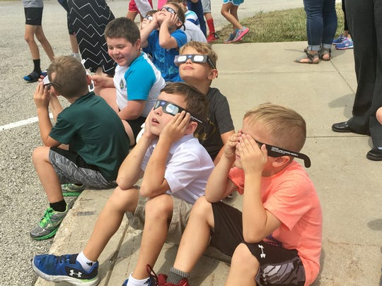Third-graders at Maple Glen Elementary in Westfield look up at the partial eclipse Monday, Aug. 21, 2017.