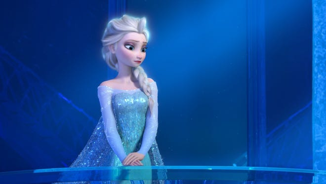 """This image released by Disney shows a teenage Elsa the Snow Queen, voiced by Maia Mitchell, in a scene from the animated feature """"Frozen."""""""