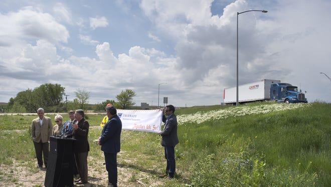 Gerry Horak, Fort Collins Mayor Pro Tem, speaks on I-25 expansion near Berthoud Thursday, May 26, 2016.