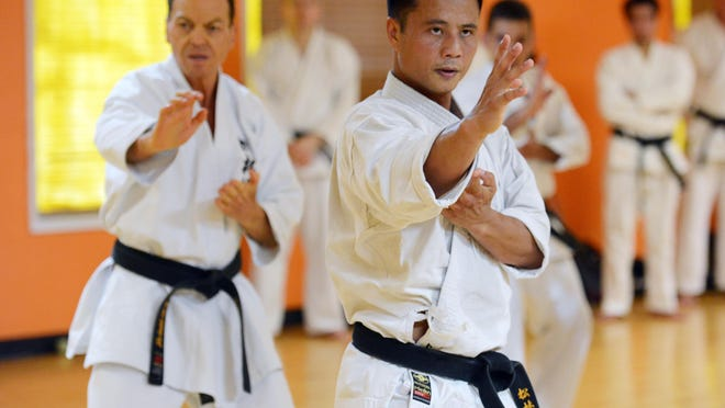 Des Chaskelson and Len Tran of Virginia perform katas during the annual Soke Nagamine Memorial Weekend at Cocoa Beach Karate. Students and instructors from all over the US gathered in Cocoa Beach for a weekend of friendship and karate.