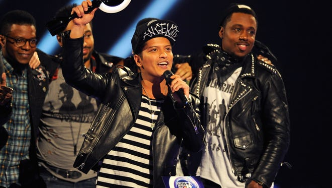 Bruno Mars receives the award for International Male Solo Artist at The BRIT Awards 2014 at 02 Arena  in London.