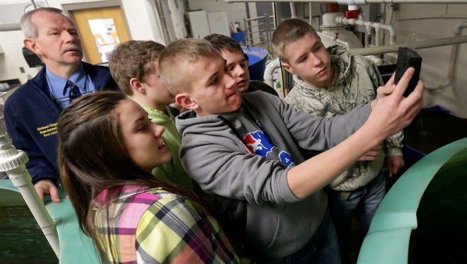 Freedom High School teacher Paul Larson, left, watches as students test water quality in Freedom on Wednesday, January 13, 2016. Larson received an Outstanding Agricultural Teacher Award from the National Association of Agricultural Educators.
