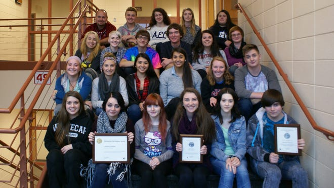 A group shot of the current Fond du Lac High School Cardinal Columns staff with adviser Matt Smith (top left). The student publication earned the prestigious National Pacemaker Award.
