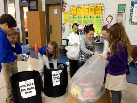 Hayden R. Lawrence Upper Elementary students sort waste into recycle bins in the school's gym. The school was recognized as a top collector of snack bag waste in a free national recycling program created by The Hain Celestial Group, Inc. and TerraCycle, collecting more than 17,600 bags.
