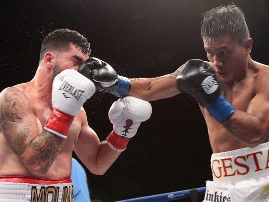 Super Lightweights Mercito Gesta, in blue tape on gloves