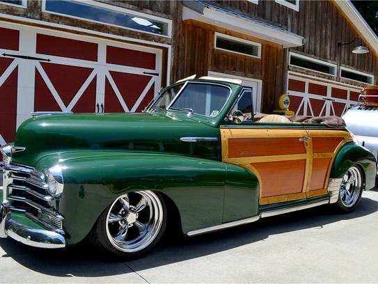 This custom woody convertible has modern suspension,