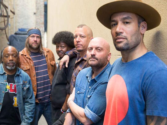 Ben Harper, far right, poses with the members of the