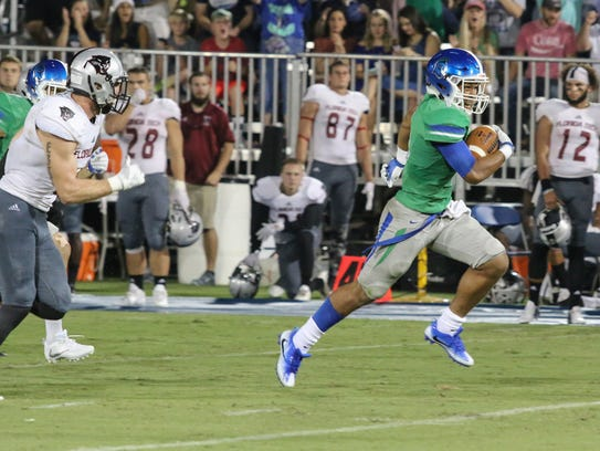 West Florida's Ishmel Morrow (11) beats the Florida