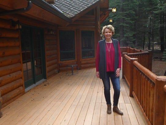 Heidi Marker poses at a Shingletown vacation home she