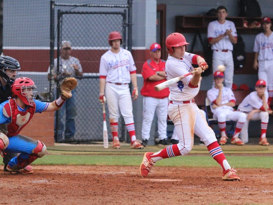 Pace's Dalton Childs (13) swings at a high pitch thrown