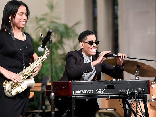 Pianist Matthew Whitaker, right, and saxophonist Gabby