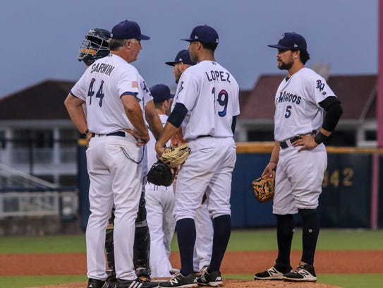 Pensacola pitching coach Danny Darwin (44) talks with