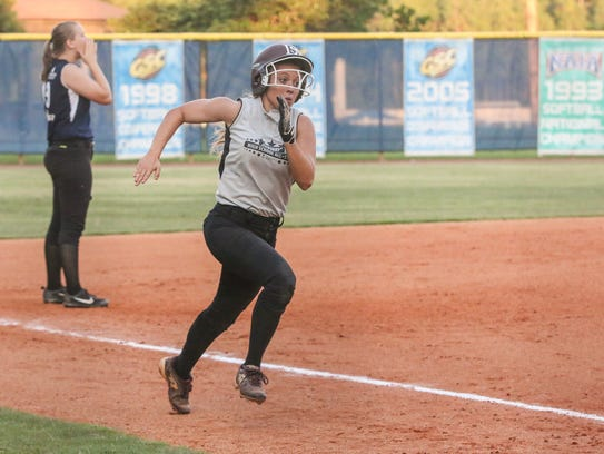 Navarre's Holly Koch (3) races home on a three-run