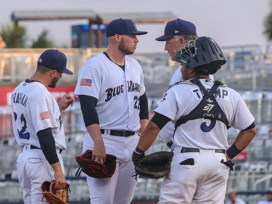 Blue Wahoos pitching coach Danny Darwin, second from