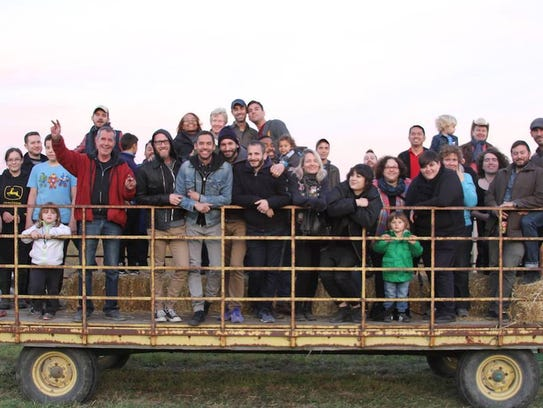 Guests gather for a hayride at a past Out on the Farm.