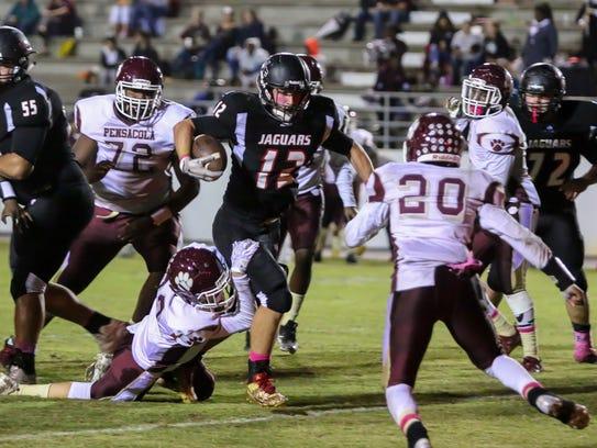 West Florida's Bryant Johnecheck (12) breaks through