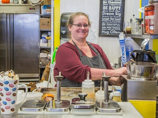 Diane Reeder is shown at her Kingston Candy Bar shop.