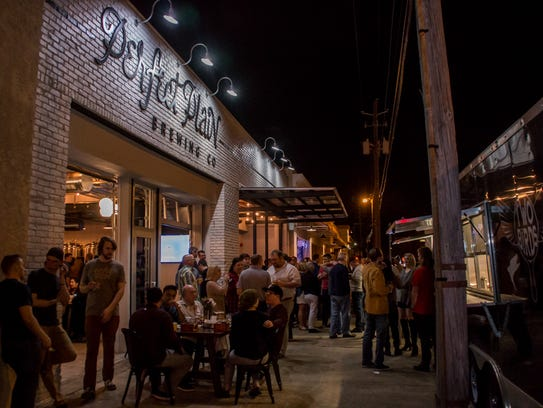 Hundreds of people celebrate the grand opening of Perfect
