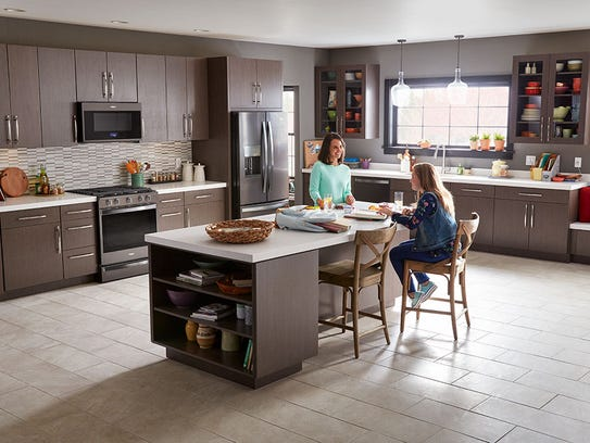Black stainless-steel appliances are complimentary