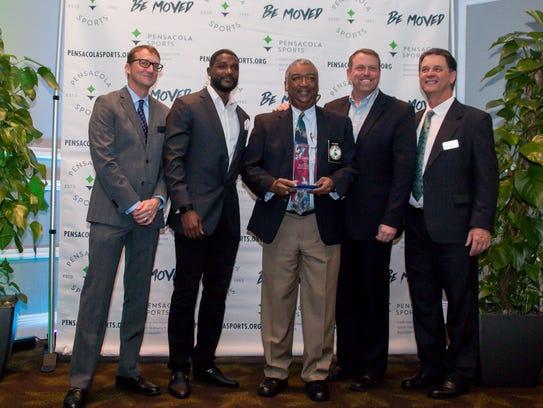 Billy Brent, center, receives a special achievement