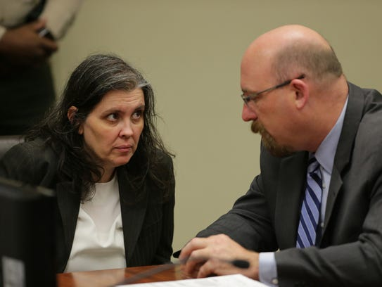 Louise Turpin, left, speaks to her attorney, Jeff Moore, during an initial court hearing on Thursday. The Turpin couple are being charged with child endangerment and torturing their children.