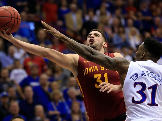 Iowa State forward Georges Niang, left, shoots while covered by Kansas forward Jamari Traylor, right, during the second half of an NCAA college basketball game in Lawrence, Kan., Saturday, March 5, 2016. Kansas defeated Iowa State 85-78. (AP Photo/Orlin Wagner)