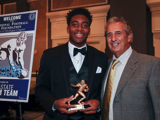 Detroit Free Press 2017 All-State Dream Team member La'Darius Jefferson poses for a photo with N.F.F. State of Michigan Chapter president Tony Versaci during the National Football Foundation State of Michigan Chapter awards banquet at the Dearborn Inn on Sunday.