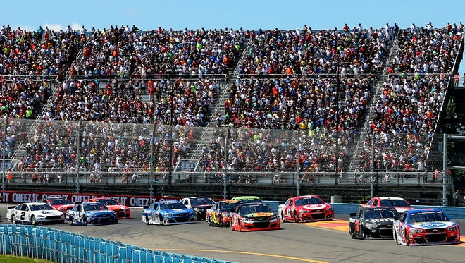 The Turn 1 grandstands are filled to capacity at Watkins Glen International last year at the start of the Cheez-It 355 at The Glen.
