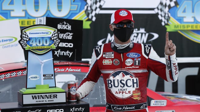 Kevin Harvick celebrates after winning Sunday's NASCAR Cup Series Consumers Energy 400 at Michigan International Speedway.