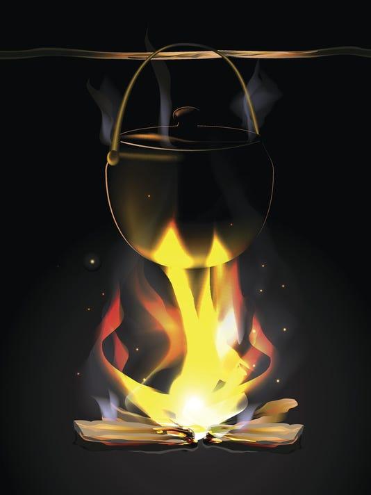 Antique black kettles on an open fire