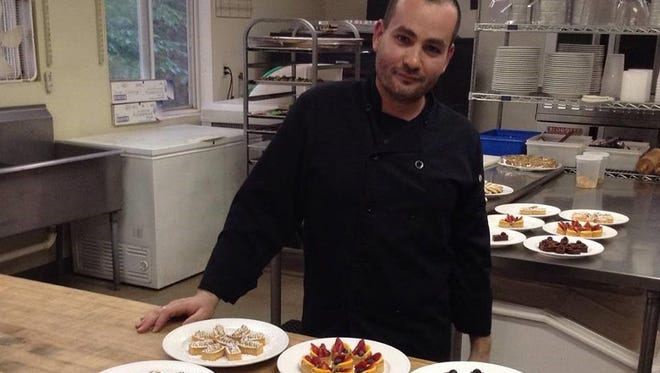 Chef Doran Brooks shows some of his desserts.