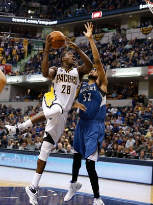 Indiana Pacers center Ian Mahinmi (28) takes a shot against Minnesota Timberwolves center Karl-Anthony Towns (32) at Bankers Life Fieldhouse. Indiana defeats Minnesota 107-103.