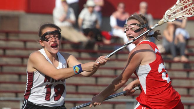 Fox Lane's Keely Connors shoots under pressure from Nyack's Shannon Salemo during their game at Nyack May 4, 2015. Fox Lane won 15-9.