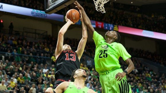 Feb 16, 2017; Eugene, OR, USA; Oregon Ducks forward Chris Boucher (25) and Oregon Ducks forward Dillon Brooks (24) defend against Utah Utes forward David Collette (13) at Matthew Knight Arena. Mandatory Credit: Scott Olmos-USA TODAY Sports