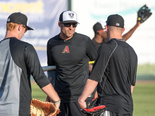 Visalia Rawhide's new manager Joe Mather, center, leads practice at Recreation Park on Tuesday, April 3, 2018. Their season opener is Thursday.