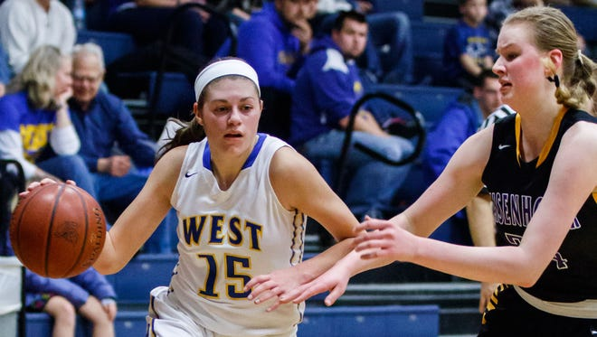 New Berlin West senior Alyssa Nelson (15) makes a run from the corner during the game at home against New Berlin Eisenhower on Tuesday, Jan. 23, 2018.