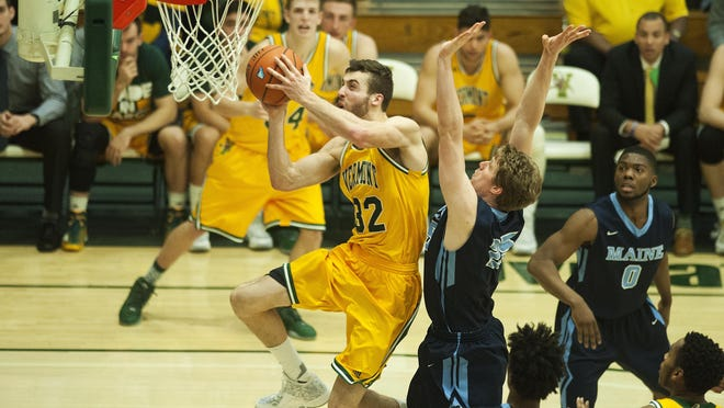 Catamounts forward Ethan O'Day (32) leaps for a layup during the America East quarterfinal men's basketball game between the Maine Black Bears and the Vermont Catamounts on Wednesday.