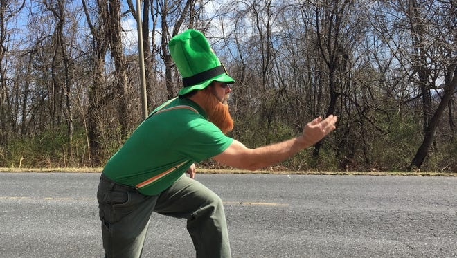 Corey Baldwin, of New Hope, launches a shot down the road during a game of Irish Road Bowling at Montgomery Hall Park in Staunton, Va., on Saturday, March 18, 2017.