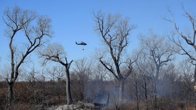 National Guard Black Hawk helicopters helped fight the Wheat State Fire near Burrton in Harvey County on Nov. 14 and 15. Winter is a prime time for wildfires in Kansas.