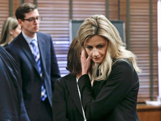 Sportscaster and television host Erin Andrews leaves the courtroom during a break after her attorney presented his closing argument Friday, March 4, 2016, in Nashville