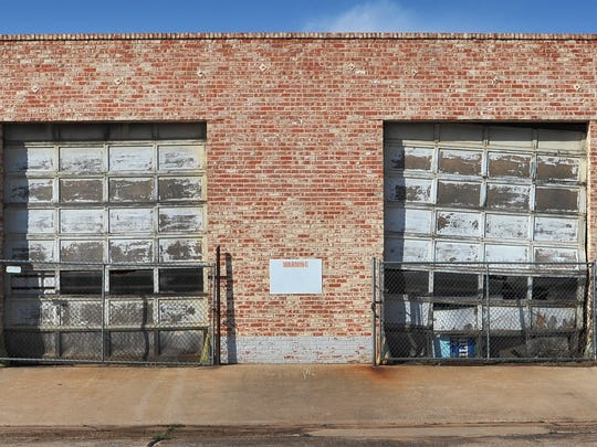 Buildings like this one near the proposed new municipal complex location could be demolished if the city's proposal gets voter approval in May.