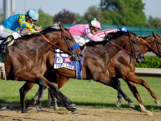 FILE - In this photo taken Saturday, May 2, 2015,  jockey Gary Stevens (10) and Firing Line, lead eventual winner American Pharoah, ridden by Victor Espinoza, left, during the 141st running of the Kentucky Derby horse race at Churchill Downs in Louisville, Ky. Stevens nearly won another Derby two weeks ago aboard Firing Line. The 52-year-old rider knows his way around Pimlico Race Course, too, and says his once-aching knees are feeling great and he's ready to go in the Preakness. (AP Photo/Matt Slocum, File)