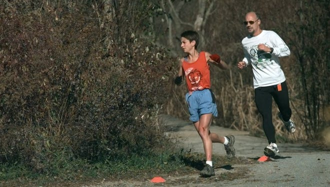 Two trail runners tackle seven miles in Black Creek Park in 2000.