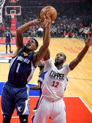 Memphis Grizzlies forward Jarell Martin, left, shoots as Los Angeles Clippers forward Luc Mbah a Moute, of Cameroon, defends during the first half of an NBA basketball game Wednesday, Jan. 4, 2017, in Los Angeles. (AP Photo/Mark J. Terrill)