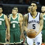 Jan 28, 2016; Memphis, TN, USA; Memphis Grizzlies guard Courtney Lee (5) shoots a technical foul free throw during the first quarter against the Milwaukee Bucks at FedExForum. Mandatory Credit: Nelson Chenault-USA TODAY Sports